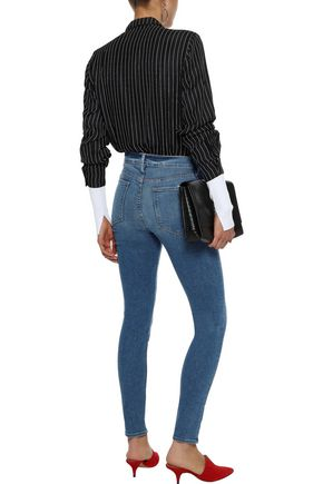 FRAME Le High faded high-rise skinny jeans