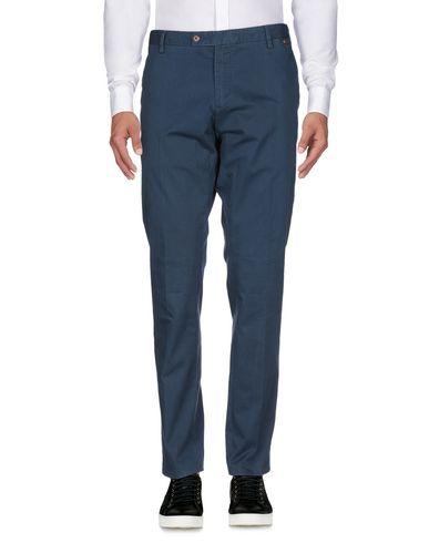 Фото 2 - Повседневные брюки от AT.P.CO синего цвета