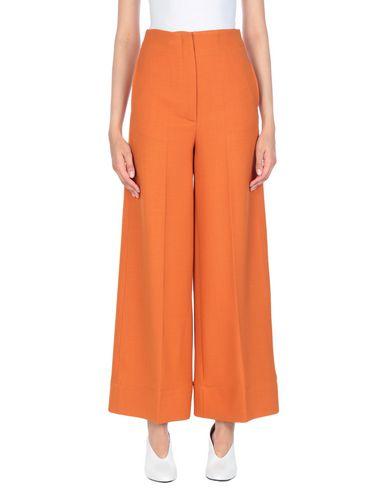 Фото - Повседневные брюки от JUCCA оранжевого цвета