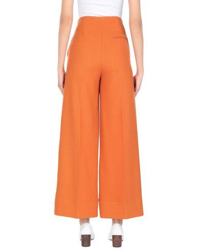 Фото 2 - Повседневные брюки от JUCCA оранжевого цвета