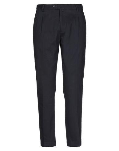 Фото - Повседневные брюки от EXIBIT темно-синего цвета