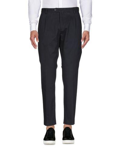 Фото 2 - Повседневные брюки от EXIBIT темно-синего цвета