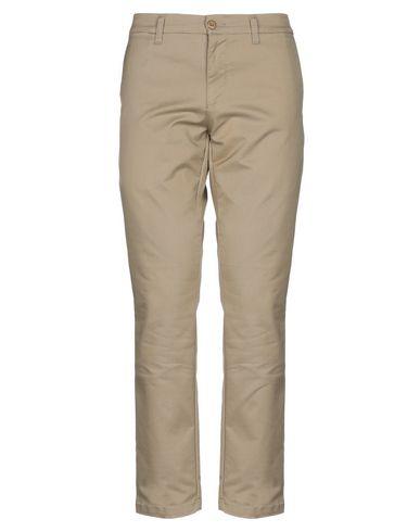 Фото - Повседневные брюки от CARHARTT бежевого цвета