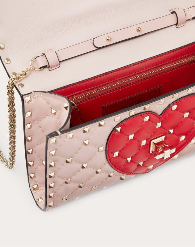 Heart exclusive Spike.it leather crossbody clutch