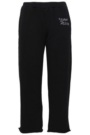 SIMON MILLER Embroidered French cotton-terry track pants