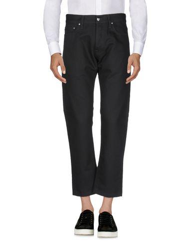 Фото 2 - Повседневные брюки от CARHARTT черного цвета