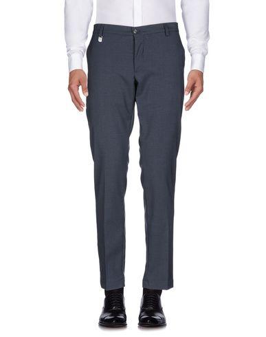 Фото 2 - Повседневные брюки от DESICA DESIDERIO CAMPANO синего цвета