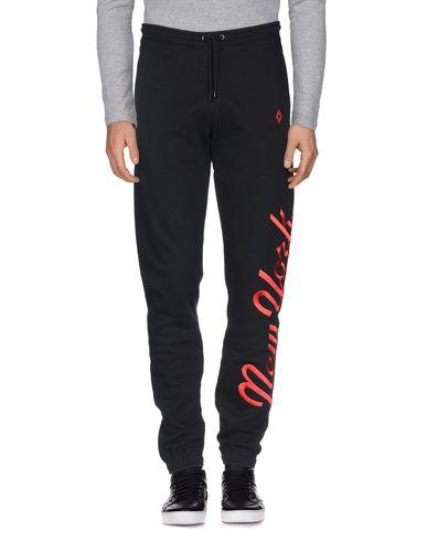 Фото 2 - Повседневные брюки от MARCELO BURLON черного цвета