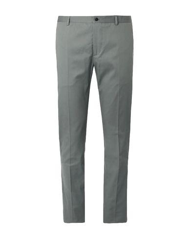 Фото - Повседневные брюки зеленого цвета