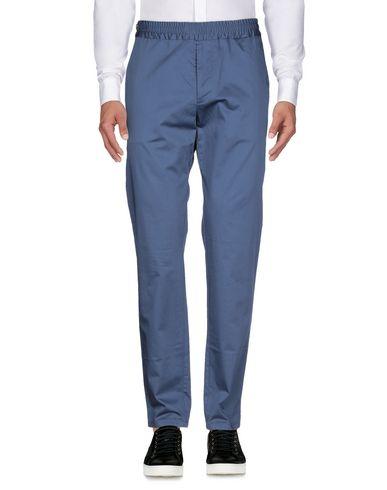 Фото 2 - Повседневные брюки от ATELIER NOTIFY синего цвета