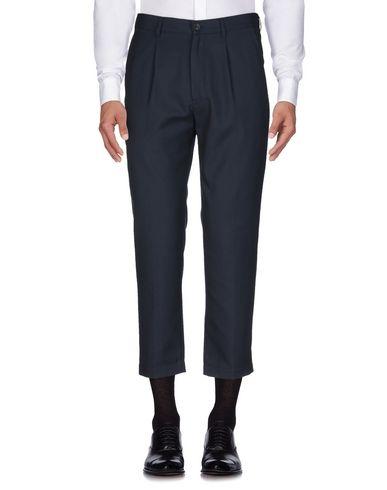 Фото 2 - Повседневные брюки от COVERT темно-синего цвета