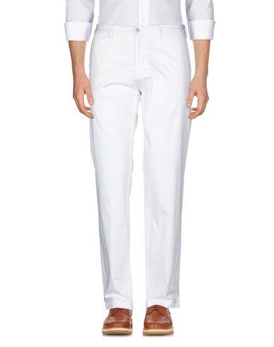 Фото 2 - Повседневные брюки белого цвета