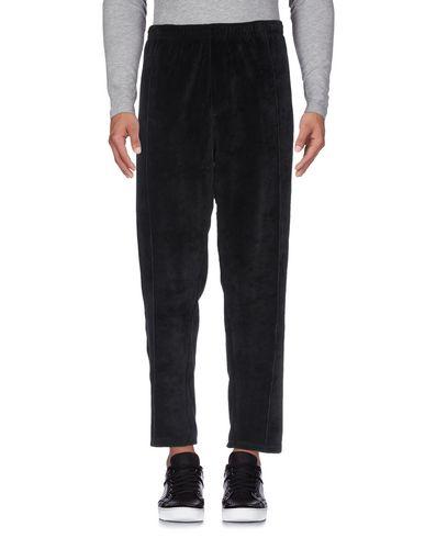 Фото 2 - Повседневные брюки от OBEY черного цвета
