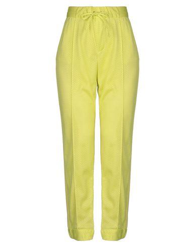Фото - Повседневные брюки от MSGM желтого цвета