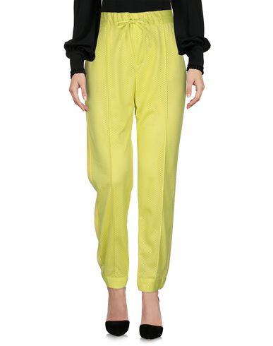 Фото 2 - Повседневные брюки от MSGM желтого цвета