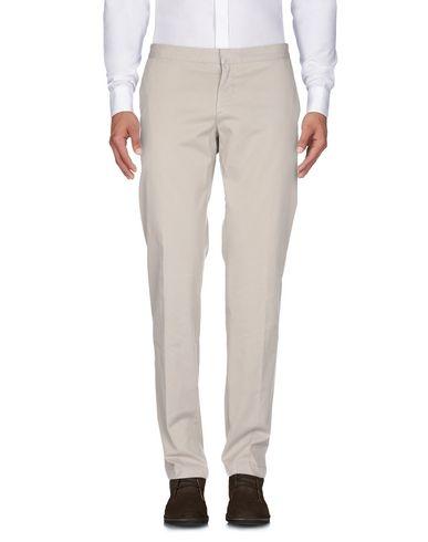 Фото 2 - Повседневные брюки от ELEVENTY бежевого цвета