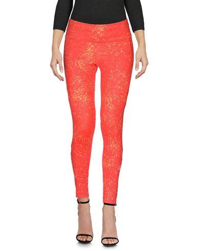 Фото 2 - Легинсы оранжевого цвета