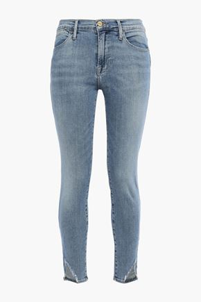 FRAME Cropped frayed mid-rise skinny jeans