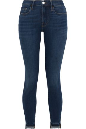 FRAME Le Skinny De Jeanne frayed low-rise skinny jeans