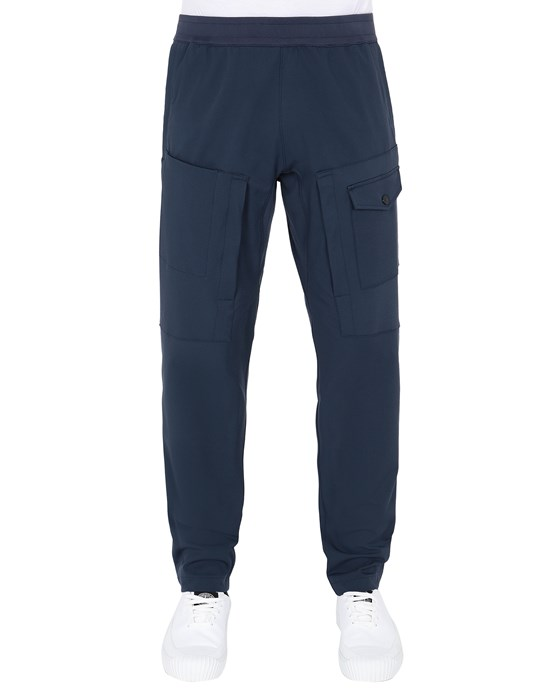 Sold out - STONE ISLAND 312X4 STONE ISLAND MARINA<br>TWO-WAY STRETCH RECYCLED NYLON TWILL Trousers Man Avio Blue