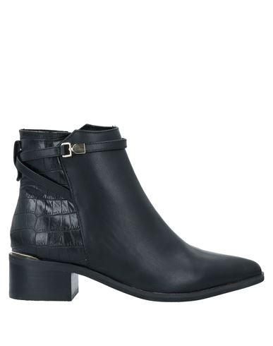Полусапоги и высокие ботинки EXE'