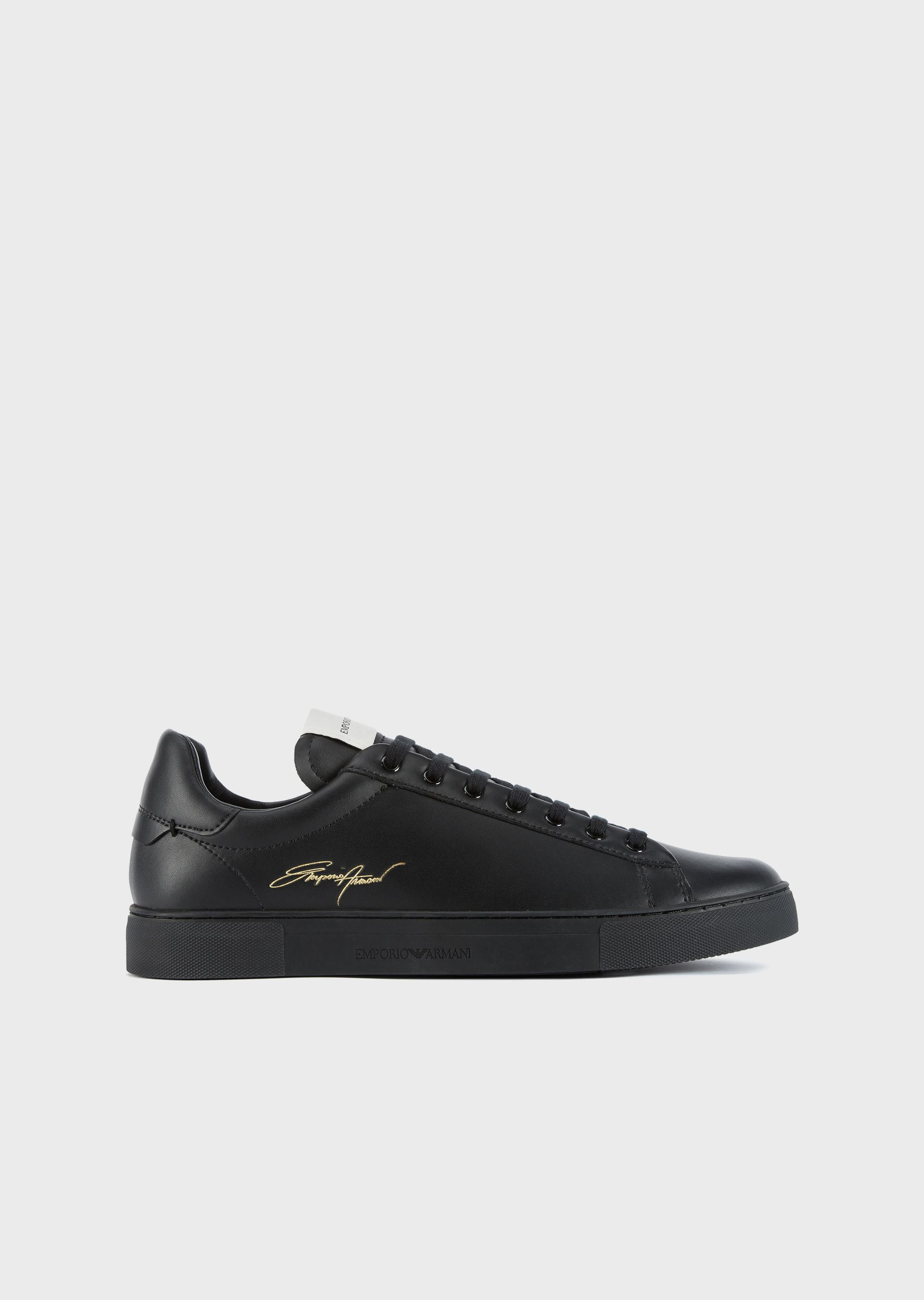 EMPORIO ARMANI Leather sneakers with gold signature logo