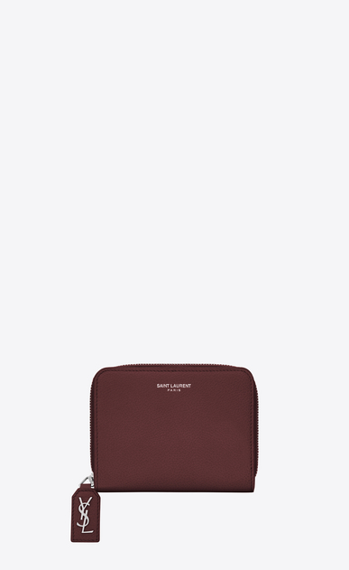 SAINT LAURENT Rive gauche SLG D RIVE GAUCHE Compact Zip Around Wallet with Monogrammed Pull in Dark Red Grained Leather  a_V4