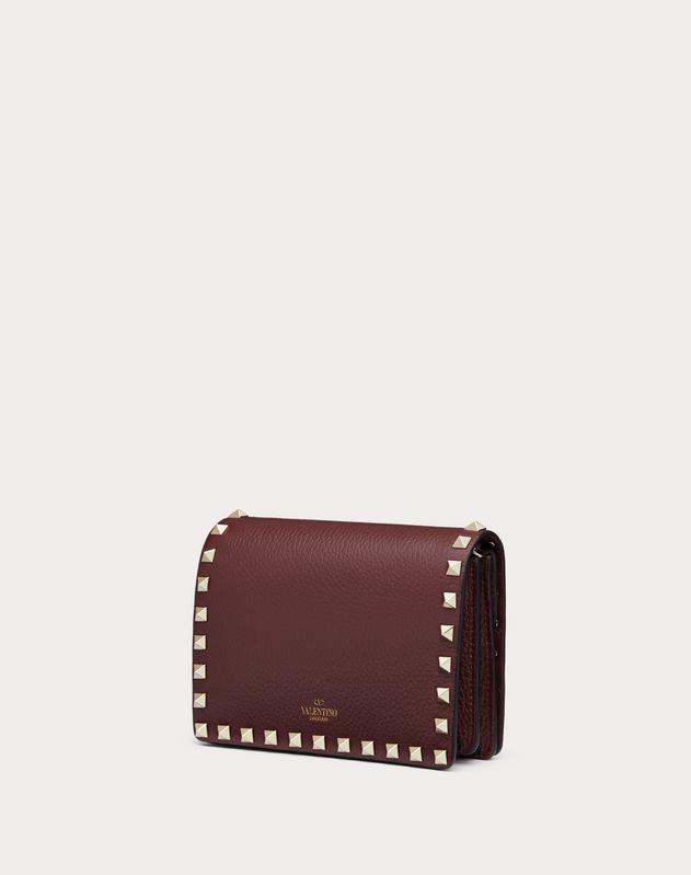 Bolso pouch con cadena Rockstud