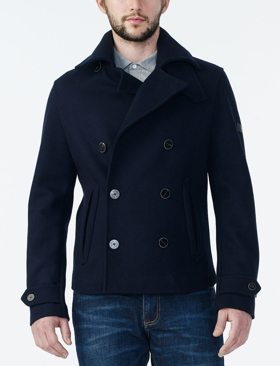 What is a Pea Coat? With its marine origins, a pea coat is defined as a short double-breasted overcoat which was typically made with heavy melton cloth. It traditionally features large notch lapels and has bigger buttons on the front of the jacket.