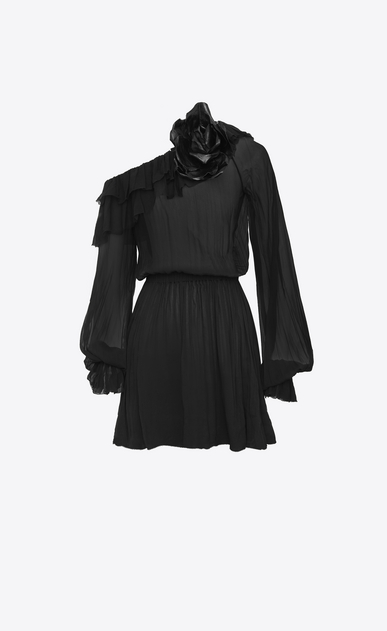 Asymmetrical mini dress with ruffles and a flower brooch in black silk muslin