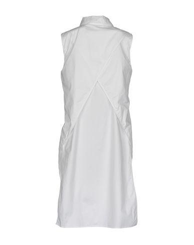 Фото 2 - Pубашка от DKNY белого цвета