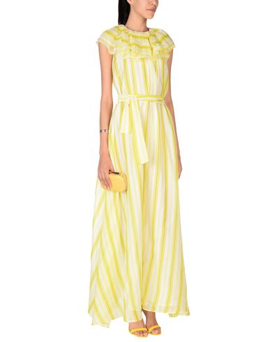 Фото 2 - Женское длинное платье MSGM желтого цвета