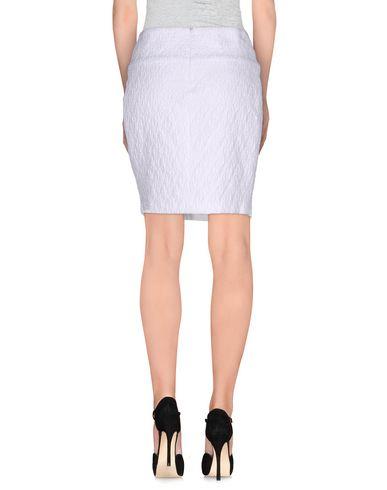 Фото 2 - Мини-юбка от PT0W белого цвета