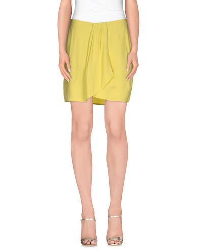 Фото - Мини-юбка желтого цвета