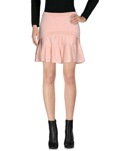 Фото - Мини-юбка розового цвета
