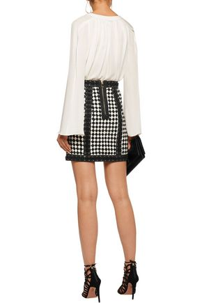 BALMAIN Lace up-detailed paneled leather and suede mini skirt