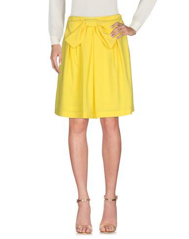 Фото - Юбку до колена от SHIRTAPORTER желтого цвета