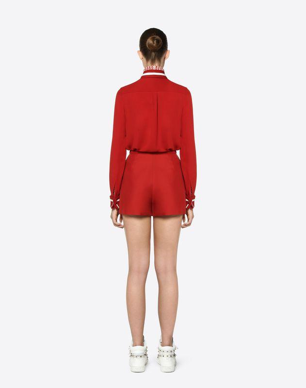 Mini-jupe pantalon en cady de soie et laine avec détails V dorés