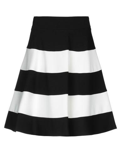 Фото - Юбку до колена от CLIPS MORE белого цвета