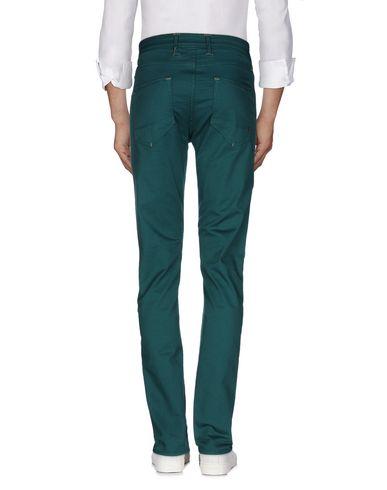 Фото 2 - Повседневные брюки изумрудно-зеленого цвета