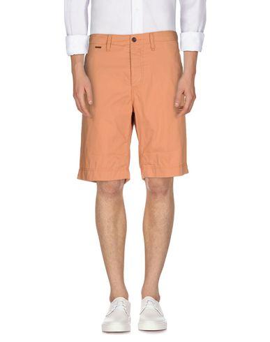 Фото - Мужские бермуды  оранжевого цвета