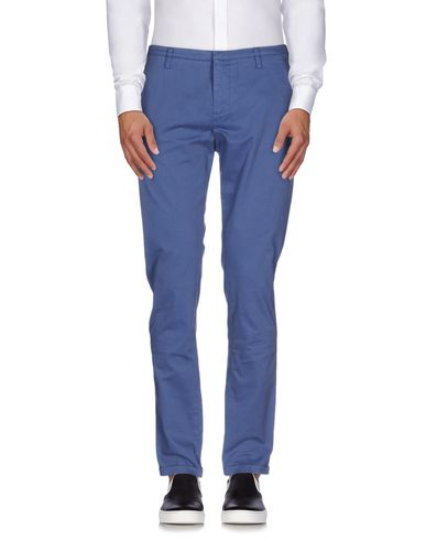 Фото - Повседневные брюки от GUNS DISARMED пастельно-синего цвета