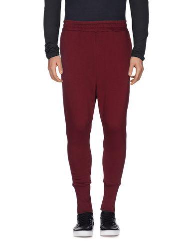 Фото - Повседневные брюки от PAURA красно-коричневого цвета