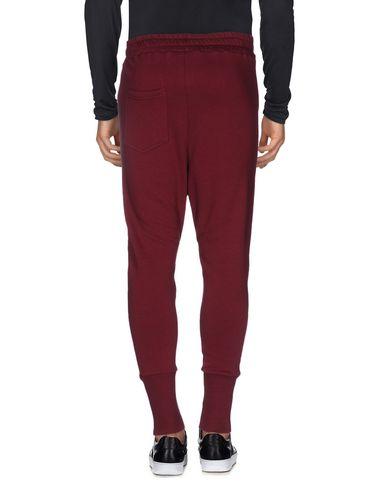 Фото 2 - Повседневные брюки от PAURA красно-коричневого цвета