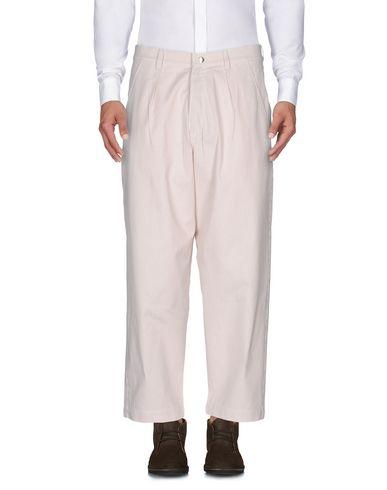 Фото - Повседневные брюки от HIRO YUKORAMA бежевого цвета