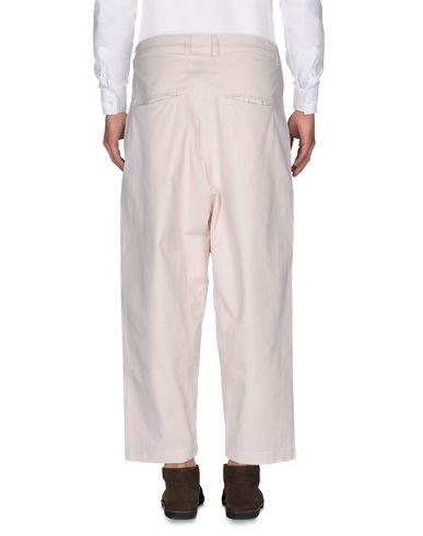 Фото 2 - Повседневные брюки от HIRO YUKORAMA бежевого цвета