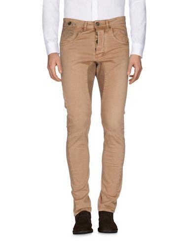 Фото - Повседневные брюки от RUMJUNGLE цвета хаки