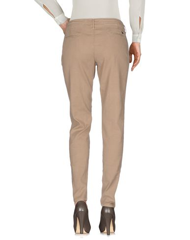 Фото 2 - Повседневные брюки от ZERO ZERO бежевого цвета