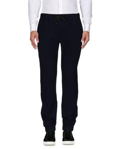Фото - Повседневные брюки от ELEVENTY темно-синего цвета