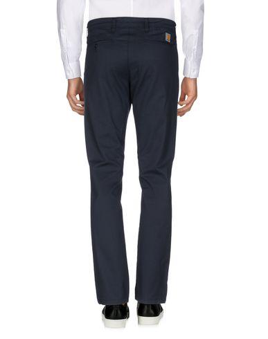 Фото 2 - Повседневные брюки от CARHARTT темно-синего цвета